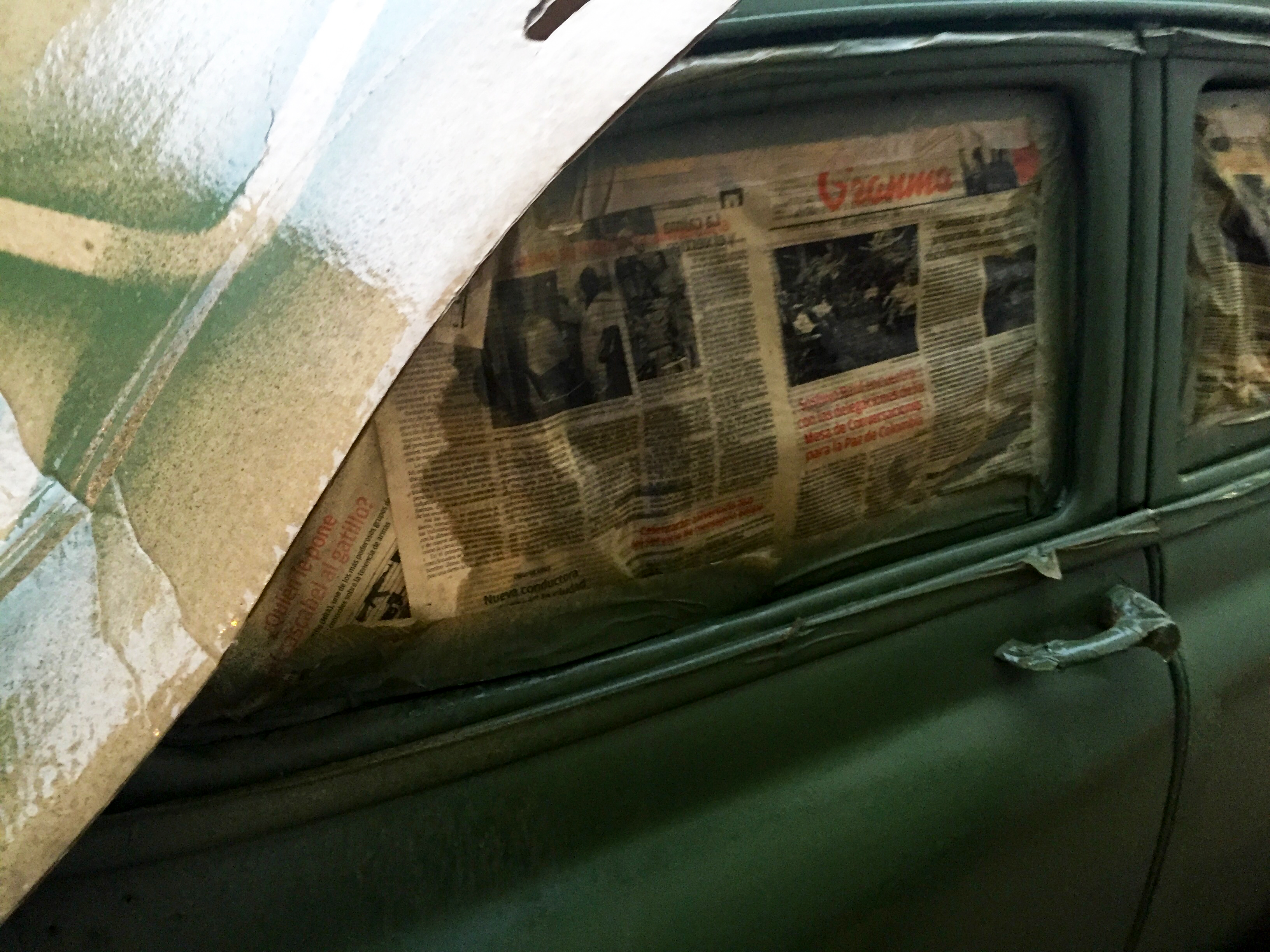 Newspapers blocking a car's windows