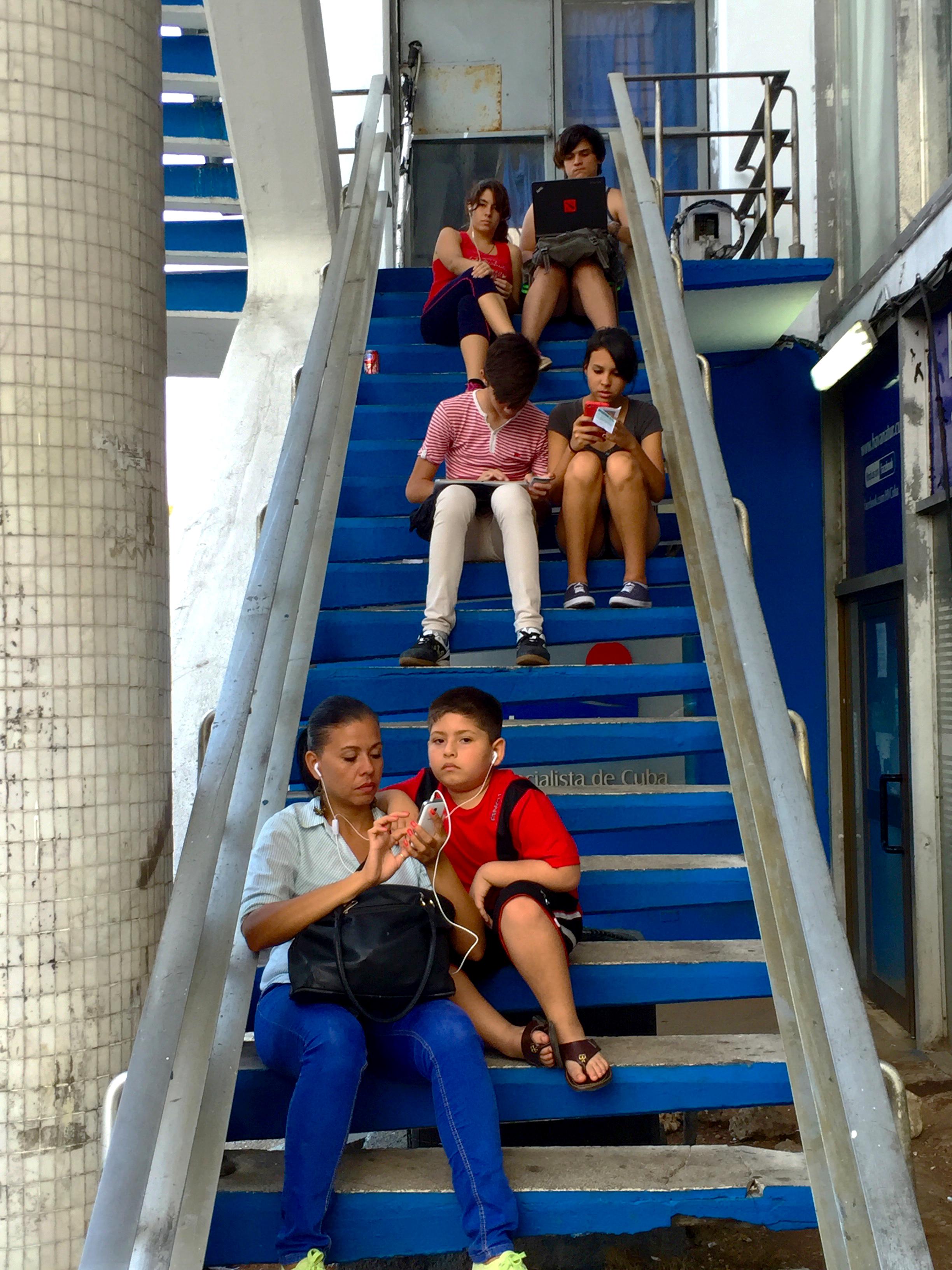 Cubans using a wifi hotspot