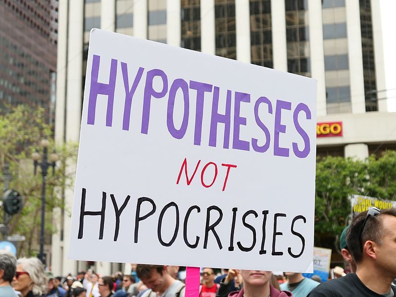 At the March on Science, a protester yields a 'Hypotheses Not Hypocrisies' sign