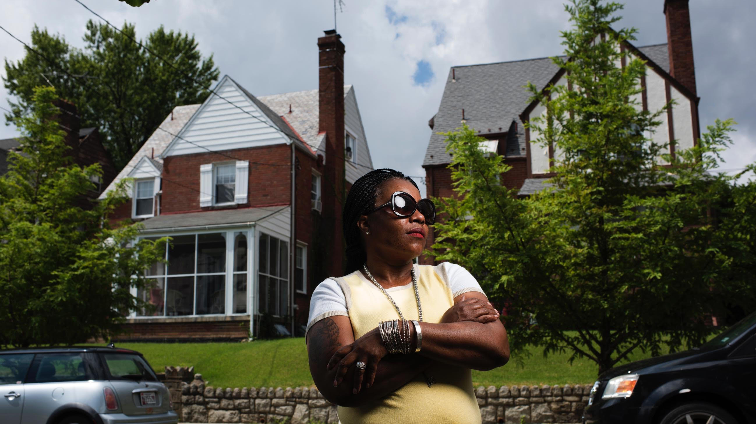 Rajuawn Middleton stands outside the house where she was forced her to leave in Washington, D.C. on August 21, 2016